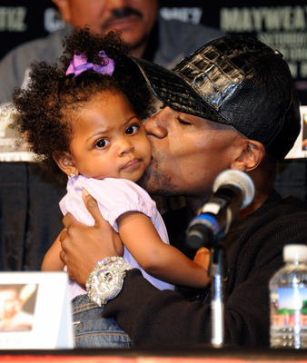 LAS VEGAS, NV - SEPTEMBER 14:  Boxer Floyd Mayweather Jr. plays with his 19-month-old niece Brielle Smith during the final news conference for his bout against Victor Ortiz at the MGM Grand Hotel/Casino September 14, 2011 in Las Vegas, Nevada. Mayweather