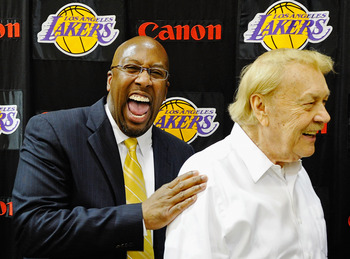 EL SEGUNDO, CA - MAY 31:  Mike Brown, (L) the new head coach for the Los Angeles Lakers, laughs with team owner Jerry Buss after Brown's introductory news conference at the team's training facility on May 31, 2011 in El Segundo, California. Brown replaces