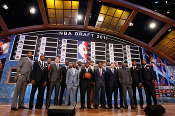 NEWARK, NJ - JUNE 23:  The 2011 Draft class including Kyrie Irving, Derrick Williams, Enes Kanter, Jonas Valanciunas, Brandon Knight, Jimmer Fredette and Kemba Walker pose for a group photo during the 2011 NBA Draft at the Prudential Center on June 23, 20