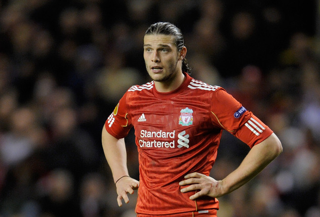 LIVERPOOL, ENGLAND - MARCH 17:  Andy Carroll of Liverpool looks dejected during the UEFA Europa League Round of 16 second leg match between Liverpool and SC Braga at Anfield on March 17, 2011 in Liverpool, England.  (Photo by Michael Regan/Getty Images)