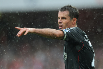 LONDON, ENGLAND - AUGUST 20:  Jamie Carragher of Liverpool directs his team during the Barclays Premier League match between Arsenal and Liverpool at the Emirates Stadium on August 20, 2011 in London, England.  (Photo by Michael Regan/Getty Images)