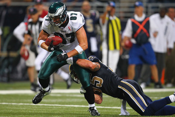 ST. LOUIS - SEPTEMBER 11: Brent Celek #87 of the Philadelphia Eagles escapes a tackle attempt by James Laurinaitis #55 of the St. Louis Rams at the Edward Jones Dome on September 11, 2011 in St. Louis, Missouri. The Eagles beat the Rams 31-13. (Photo by D