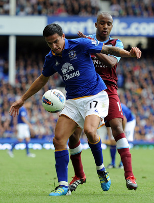 LIVERPOOL, ENGLAND - SEPTEMBER 10:  Tim Cahill (L) of Everton competes with Fabian Delph of Aston Villa during the Barclays Premier League match between Everton and Aston Villa at Goodison Park on September 10, 2011 in Liverpool, England.  (Photo by Chris