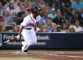 ATLANTA, GA - AUGUST 19:  Center fielder Michael Bourn #24 of the Atlanta Braves gets out of the batter's box after making contact during the game against the Arizona Diamondbacks at Turner Field on August 19, 2011 in Atlanta, Georgia.  (Photo by Mike Zar