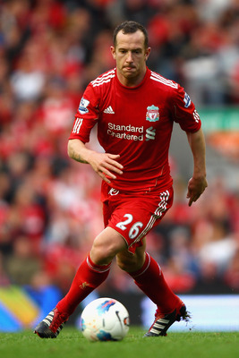 LIVERPOOL, ENGLAND - AUGUST 27:  Charlie Adam of Liverpool with the ball during the Barclays Premier League match between Liverpool and Bolton Wanderers at Anfield on August 27, 2011 in Liverpool, England.  (Photo by Clive Brunskill/Getty Images)