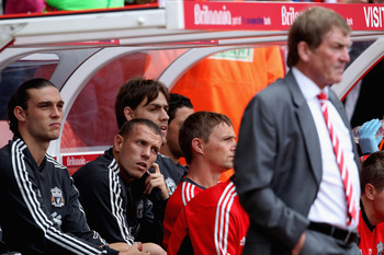 STOKE ON TRENT, ENGLAND - SEPTEMBER 10:  Andy Crroll (L) and Craig Bellamy sit on the Liverpool  bench behind their manager Kenny Dalglish prior to the Barclays Premier League match between Stoke City and Liverpool at Britannia Stadium on September 10, 20