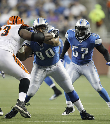 DETROIT - AUGUST 12:  Ndamukong Suh #90 of the Detroit Lions and Bobbie WIlliams #63 of the Cincinnati Bengals fight for position during the second quarter of the game at Ford Field on August 12, 2011 in Detroit, Michigan.  (Photo by Leon Halip/Getty Imag