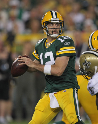 GREEN BAY, WI - SEPTEMBER 08:  Aaron Rodgers #12 of the Green Bay Packers looks for a receiver against the New Orleans Saints during the NFL opening season game at Lambeau Field on September 8, 2011 in Green Bay, Wisconsin. The Packers defeated the Saints