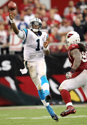 GLENDALE, AZ - SEPTEMBER 11:  Quarterback Cam Newton #1 of the Carolina Panthers throws a pass during the NFL season opening game against the Arizona Cardinals at the University of Phoenix Stadium on September 11, 2011 in Glendale, Arizona. The Carindals