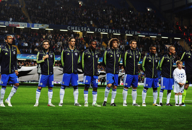 LONDON, ENGLAND - SEPTEMBER 13:  Fernando Torres (4th left) of Chelsea lines up alongside his team mates before the start of the UEFA Champions League group E match between Chelsea FC and Bayer 04 Leverkusen at Stamford Bridge on September 13, 2011 in Lon