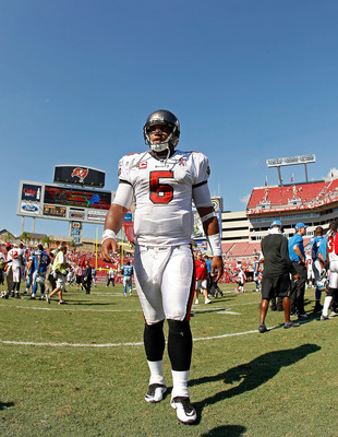 TAMPA, FL - SEPTEMBER 11:  Josh Freeman #5 of the Tampa Bay Buccaneers walks off the field after the season opener against the Detroit Lions at Raymond James Stadium on September 11, 2011 in Tampa, Florida.  (Photo by Mike Ehrmann/Getty Images)