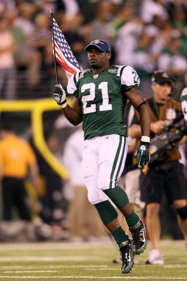 EAST RUTHERFORD, NJ - SEPTEMBER 11:  LaDainian Tomlinson #21 of the New York Jets runs with an American Flag on to the field during pregame festivities against the Dallas Cowboys during their NFL Season Opening Game at MetLife Stadium on September 11, 201