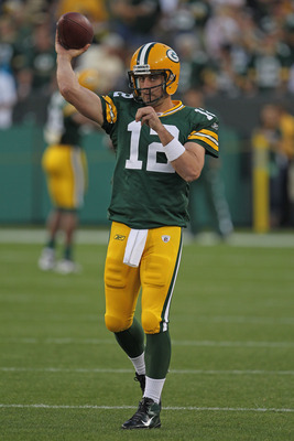 GREEN BAY, WI - SEPTEMBER 08:  Aaron Rodgers #12 of the Green Bay Packers throws a pass during warm-ups before the NFL opening season game against the New Orleans Saints at Lambeau Field on September 8, 2011 in Green Bay, Wisconsin. The Packers defeated t