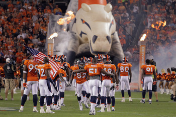 DENVER, CO - SEPTEMBER 12:  The Denver Broncos take the field to face the Oakland Raiders at Sports Authority Field at Mile High on September 12, 2011 in Denver, Colorado.  (Photo by Doug Pensinger/Getty Images)