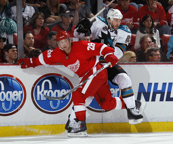 DETROIT - MAY 6: Brian Rafalski #28 of the Detroit Red Wings lays a third period hit on Ryane Clowe #29 of the San Jose Sharks in Game Four of the Western Conference Semifinals during the 2011 NHL Stanley Cup Playoffs on May 6, 2011 at Joe Louis Arena in