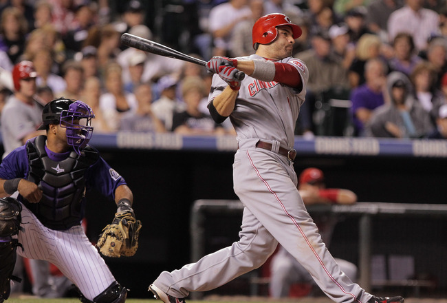 DENVER, CO - SEPTEMBER 09:  Joey Votto #19 of the Cincinnati Reds singles to score Dave Sappelt #17 of the Cincinnati Reds to tie the score 1-1 with the Colorado Rockies in the sixth inning at Coors Field on September 9, 2011 in Denver, Colorado.  (Photo