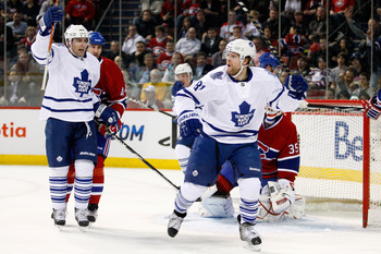 MONTREAL, CANADA - FEBRUARY 24:  Phil Kessel #81 of the Toronto Maple Leafs celebrates his first period goal during the NHL game against the Montreal Canadiens at the Bell Centre on February 24, 2011 in Montreal, Quebec, Canada.  The Maple Leafs defeated