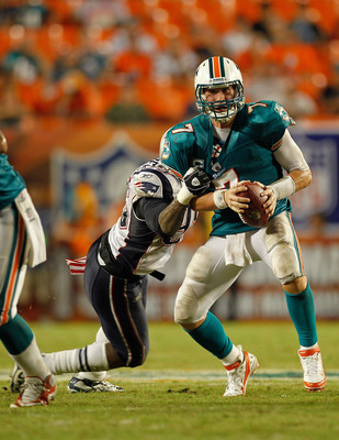 MIAMI GARDENS, FL - SEPTEMBER 12:  Chad Henne #7 of the Miami Dolphins is sacked by  Gary Guyton #59 of the New England Patriots during a game  at Sun Life Stadium on September 12, 2011 in Miami Gardens, Florida.  (Photo by Mike Ehrmann/Getty Images)
