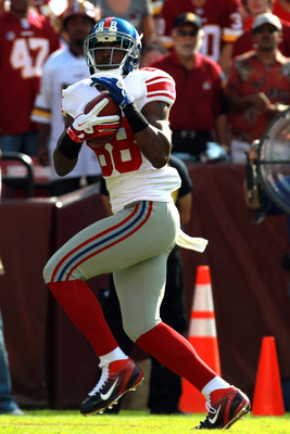 LANDOVER, MD - SEPTEMBER 11:  Wide receiver Hakeem Nicks #88 of the New York Giants catches a 68-yard reception in the first quarter in front of Kevin Barnes #22 of the Washington Redskins at FedExField on September 11, 2011 in Landover, Maryland.  (Photo