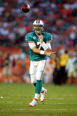 MIAMI GARDENS, FL - SEPTEMBER 12:  Quarterback Chad Henne #7 of the Miami Dolphins throws against the New England Patriots at Sun Life Stadium on September 12, 2011 in Miami Gardens, Florida.  (Photo by Marc Serota/Getty Images)
