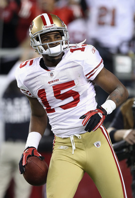 GLENDALE, AZ - NOVEMBER 29:  Wide receiver Michael Crabtree #15 of the San Francisco 49ers reacts after scoring a 38 yard touchdown reception against the Arizona Cardinals during the first quarter of the NFL game at the University of Phoenix Stadium on No