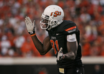 STILLWATER, OK - SEPTEMBER 8:  Wide receiver Justin Blackmon #81 of the Oklahoma State Cowboys celebrates after a play against the Arizona Wildcats during the first half on September 8, 2011 at Boone Pickens Stadium in Stillwater, Oklahoma.  Oklahoma Stat