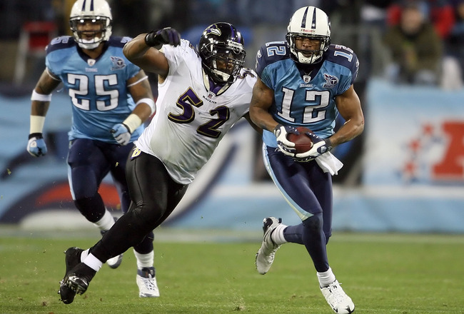 NASHVILLE, TN - JANUARY 10:  Wide receiver Justin Gage #12 of the Tennessee Titans looks to avoid a tackle by Ray Lewis #52 of the Baltimore Ravens in the second quarter during the AFC Divisional Playoff Game on January 10, 2009 at LP Field in Nashville,