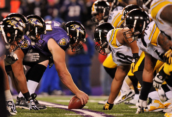 BALTIMORE, MD - DECEMBER 05:  Matt Birk #77 of the Baltimore Ravens prepares to snap the ball against the Pittsburgh Steelers at M&T Bank Stadium on December 5, 2010 in Baltimore, Maryland. Pittsburgh won 13-10.  (Photo by Larry French/Getty Images)