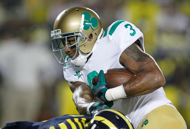 ANN ARBOR, MI - SEPTEMBER 10: Michael Floyd #3 of the Notre Dame Fighting Irish tries for extra yards after a second quarter reception over the tackle of Courtney Avery #5 of the Michigan Wolverines at Michigan Stadium on September 10, 2010 in Ann Arbor,