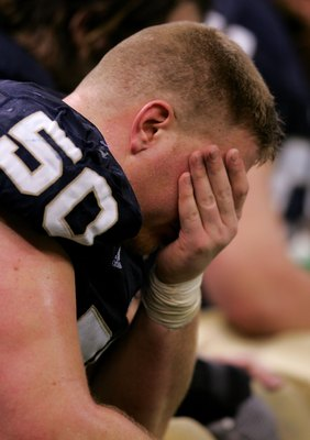 NEW ORLEANS - JANUARY 03:  Dan Santucci #50 of the Notre Dame Fighting Irish sits dejected after his team was defeated by the LSU Tigers in the 2007 Allstate Sugar Bowl on January 3, 2007 at the Superdome in New Orleans, Louisiana.  LSU won the game 41-14