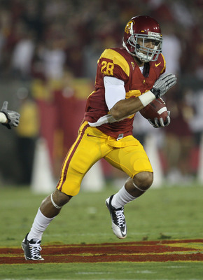LOS ANGELES, CA - SEPTEMBER 11:  Running back Dillon Baxter #28 of the USC Trojans carries the ball against the Virginia Cavaliers at Los Angeles Memorial Coliseum on September 11, 2010 in Los Angeles, California. USC won 17-14.  (Photo by Stephen Dunn/Ge