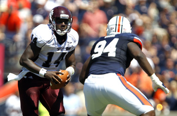 AUBURN, AL - SEPTEMBER 10:  Quarterback Chris Relf #15 of the Mississippi State Bulldogs scrambles with pressure from defensive end Nosa Eguae #94 of the Auburn Tigers in the first half on September 10, 2011 at Jordan-Hare Stadium in Auburn, Alabama. (Pho
