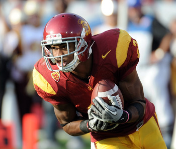 LOS ANGELES, CA - SEPTEMBER 10:  Robert Woods #2 of the USC Trojans returns a kick against the Utah Utes at Los Angeles Memorial Coliseum on September 10, 2011 in Los Angeles, California.  (Photo by Harry How/Getty Images)
