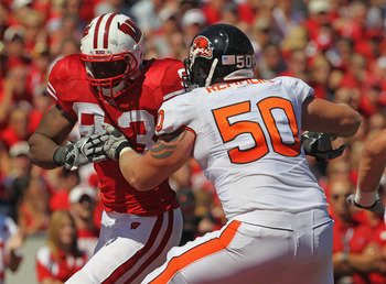 MADISON, WI - SEPTEMBER 10:  Louis Nzegwu #93 of the Wisconsin Badgers rushes against Mike Remmers #50 of the Oregon State Beavers at Camp Randall Stadium on September 10, 2011 in Madison Wisconsin. Wisconsin defeated Oregon State 35-0.  (Photo by Jonatha
