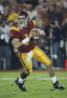 PASADENA, CA - JANUARY 04:  Quarterback Matt Leinart #11 of the USC Trojans looks for an open pass around the Texas Longhorns defense in the third quarter during the BCS National Championship Rose Bowl Game on January 4, 2006 in Pasadena, California.  (Ph