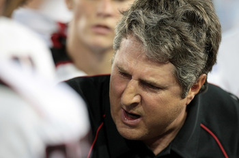 HOUSTON - SEPTEMBER 26:Head coach Mike Leach of the Texas Tech Red Raiders gives instructions to his defense against the Houston Cougars  at Robertson Stadium on September 26, 2009 in Houston, Texas.  (Photo by Thomas B. Shea/Getty Images)