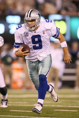 EAST RUTHERFORD, NJ - SEPTEMBER 11:  Tony Romo #9 of the Dallas Cowboys runs with the ball against the New York Jets during their NFL Season Opening Game at MetLife Stadium on September 11, 2011 in East Rutherford, New Jersey.  (Photo by Elsa/Getty Images