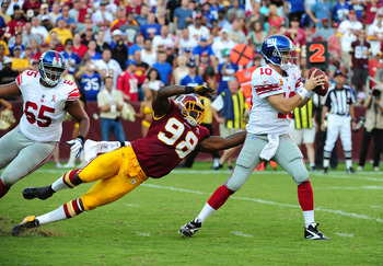 LANDOVER, MD - SEPTEMBER 11: Eli Manning #10 of the New York Giants is pressured by Brian Orakpo #98 of the Washington Redskins during the season-opening game at FedEx Field on September 11, 2011 in Landover, Maryland. (Photo by Scott Cunningham/Getty Ima