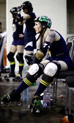 LONDON, ENGLAND - NOVEMBER 13:  Competitors prepare for action at the London Rollergirls Roller Derby event at London Earls Court Olympia on November 13, 2010 in London, England. The contact sport of Roller Derby involves two teams of four defensive playe