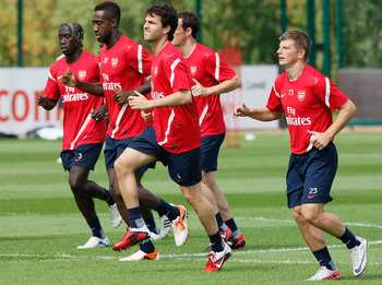 ST ALBANS, ENGLAND - AUGUST 05: Cesc Fabregas (C) of Arsenal trains with the team during a training session at London Colney on August 5, 2011 in St Albans, England. (Photo by Tom Dulat/Getty Images)