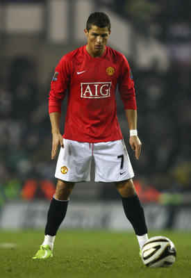 DERBY, UNITED KINGDOM - JANUARY 07:  Cristiano Ronaldo of Manchester United lines up a free kick during the Carling Cup Semi Final 1st Leg match between Derby County and Manchester United at Pride Park on January 07, 2009 in Derby, England.  (Photo by Lau