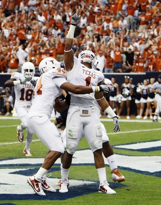 HOUSTON - SEPTEMBER 04:  Linebacker Keenan Robinson #1 of the Texas Longhorns celebrates after running back a fumble for a touchdown against the Rice Owls at Reliant Stadium on September 4, 2010 in Houston, Texas.  (Photo by Bob Levey/Getty Images)
