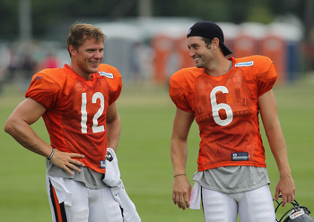 BOURBONNAIS, IL - AUGUST 06:  Caleb Hanie #12 and Jay Cutler #6 of the Chicago Bears share a laugh during a summer training camp practice at Olivet Nazarene University on August 6, 2011 in Bourbonnais, Illinois.  (Photo by Jonathan Daniel/Getty Images)