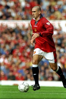 20 Aug 1996:  Eric Cantona of Manchester United in action during an FA Carling Premiership match against Blackburn Rovers at Old Trafford in Manchester, England. The match ended in a 2-2 draw. \ Mandatory Credit: Clive  Brunskill/Allsport