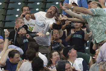 SEATTLE - AUGUST 26:  Fans reach for a foul ball during the game between the Seattle Mariners and the Chicago White Sox at Safeco Field on August 26, 2011 in Seattle, Washington. (Photo by Otto Greule Jr/Getty Images)