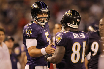 BALTIMORE, MD - AUGUST 25: Quarterback Joe Flacco #5 of the Baltimore Ravens celebrates with Anquan Boldin #81 after the pair connected for a touchdown against the Washington Redskins during the second half of a preseason game at M&T Bank Stadium on Augus