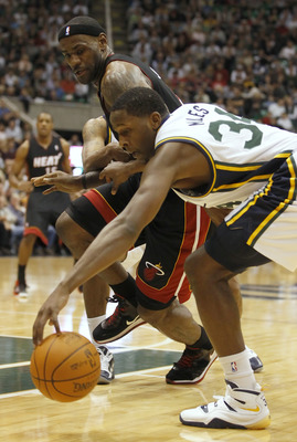 SALT LAKE CITY, UT - DECEMBER 8: LeBron James #6 of the Miami Heat  has the ball stolen by C.J. Miles #34 of the Utah Jazz during the first half of an NBA game December 8, 2010 at Energy Solutions Arena in Salt Lake City, Utah. NOTE TO USER:  User express
