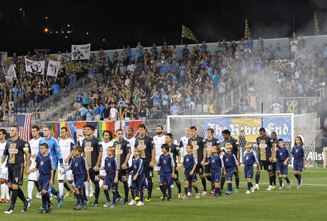 CHESTER, PA- SEPTEMBER 07: The Philadelphia Union and New England Revolution walk onto the field before the game at PPL Park on September 7, 2011 in Chester, Pennsylvania. The game ended in a 4-4 tie. (Photo by Drew Hallowell/Getty Images)