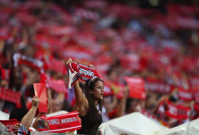LISBON, PORTUGAL - SEPTEMBER 14:  A femal SL Benfica fan during the UEFA Champions League Group C match between SL Benfica and Manchester United at the Estadio da Luz on September 14, 2011 in Lisbon, Portugal.  (Photo by Clive Mason/Getty Images)