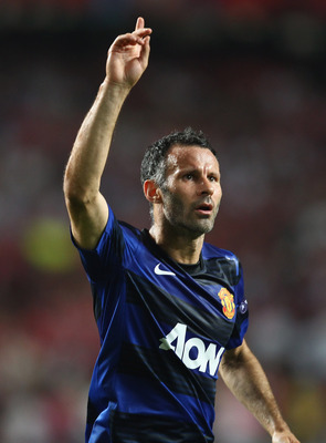 LISBON, PORTUGAL - SEPTEMBER 14:  Ryan Giggs of Manchester United celebrates his goal during the UEFA Champions League Group C match between SL Benfica and Manchester United at the Estadio da Luz on September 14, 2011 in Lisbon, Portugal.  (Photo by Clive